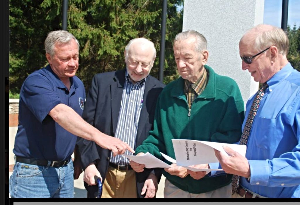 Ken Baker, Weed Tucker, Joe Kianka and Bill Meytrott all members of the Hopewell Valley Veterans Association, review the plans for this year's HV Memorial Day Ceremony