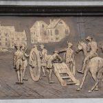 plaque at battle monument